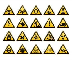 Ostrzegawcze znaki BHP a zagrożenia w miejscu pracy